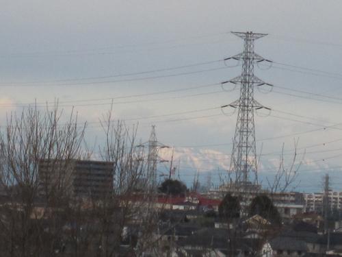 雪の男体山