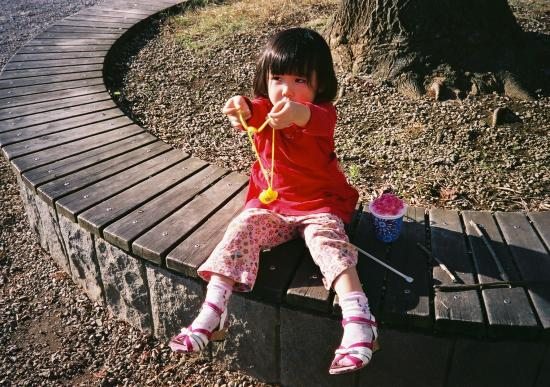 daughter on wood bench