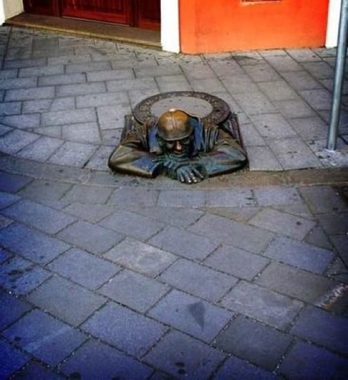 japanese-manhole-covers-bronzed-man.jpg