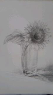花とガラスのコップ