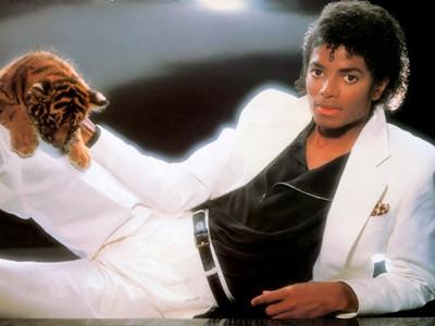 michael_jackson_official_70s_white_suit_tiger_400x300.jpg